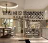 厨房和餐厅做区域的划分,餐厅做一个圆形的吊顶和方形的餐桌做对称,厨房做一个酒柜,很闲情调。用地中海风格的马赛克砖,别有一番风味。