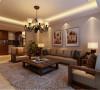 地毯和装饰画增加了空间的生气,配以实木的沙发,这种具有重量感的胡桃木色调让空间瞬间转向硬朗,在家居中有种另类的前卫。