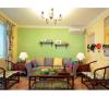 客厅其实很简单,但是用业主喜欢的颜色做了一面绿色的沙发背景墙,还有点睛的小隔板,加上木质的沙发和温暖靠垫,简单而隽永。