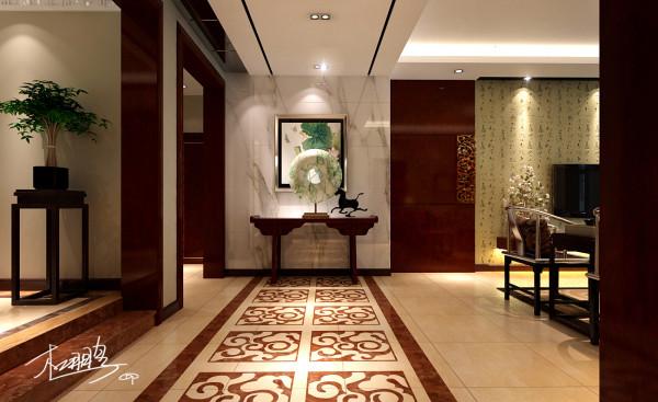 进入空间一条水波纹的地面拼花延伸至玄关,让人的视觉得到美的享受,也使空间巧妙的进行了分割,玄关墙面的大花纹石材和中式条案形成材质上粗细的对比。