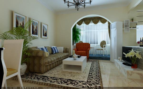客厅,电视背景墙用浅咖色文化石为基础造型,与敞开式厨房的橱柜台面做了一些色差,突出空间色彩感