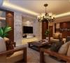 客厅整体突显出一种豪华大方的贵族之感,电视背景墙运用大理石的设计,两边配以胡桃木做装饰,电视机嵌入式。在配以带有古典气息的吊灯,使得整个空间有光影之舞。