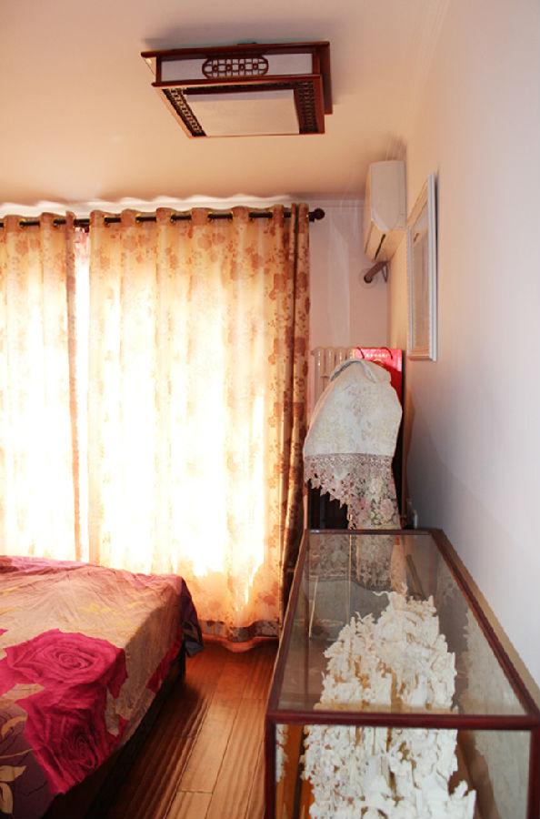 梧桐苑7号 中式风格 120平米新 今朝装饰 卧室图片来自北京今朝装饰在梧桐苑---中式风格装修的分享