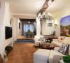 沙发背景为地中海风格的油画,电视机背景墙做了一个壁炉,所以整个背景墙甚至客厅整体的格局都发生变化。