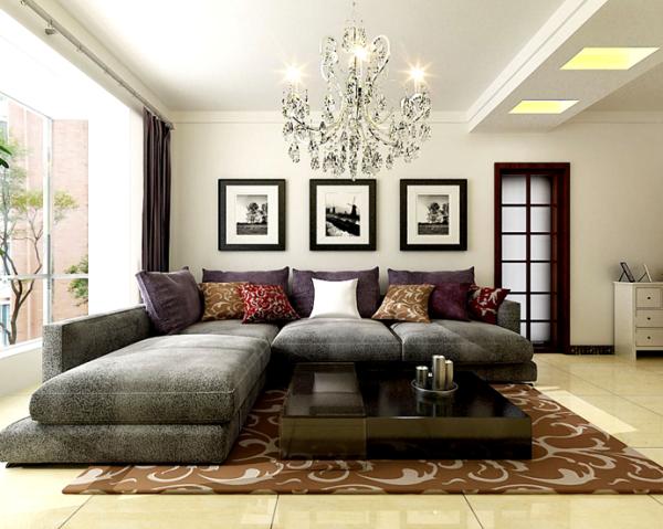 白色的墙壁,黑色的相框装饰品,营造了空间的立体效果,填充了墙壁的单调感,灰色的整体沙发,看起来舒适而沉稳,亮色的点缀,丰富了空间的无彩色的空间格调。