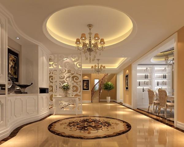 门较人性化,生活化,满足日常生活的穿衣换鞋照镜,用顶部造型划分餐厅和客厅空间,从而体现整体的一进门厅感觉整个空间大气典雅,有独立的鞋柜,用镜面做了柜风格和美观性。