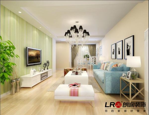 客厅做了简单的小边顶,电视墙用清新的淡绿色的墙纸点缀,简单温暖。
