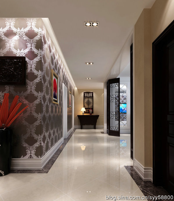 门厅的尽头是经过设计师改造后老人卧室的墙面,不但解决了原始结构上门厅对角的风水问题,还给进门增添了一抹艳丽。