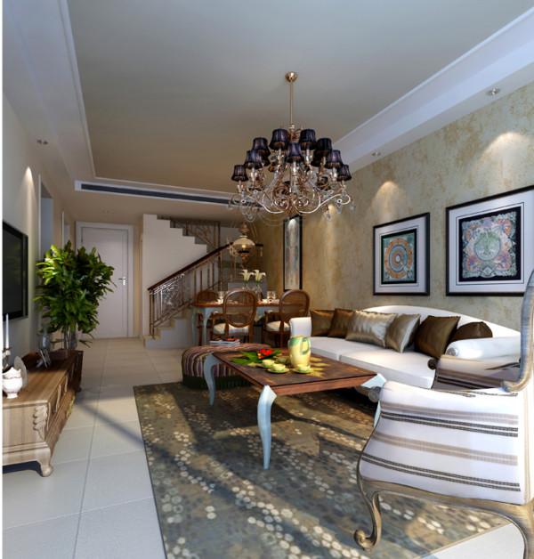没有阳台的大客厅的基础上,导致整个沙发围合的区域不够饱满,所以在客厅与窗户的交界处利用茶镜的过度,做了形式上的区域分割,且体现了欧式的大气,有张力。