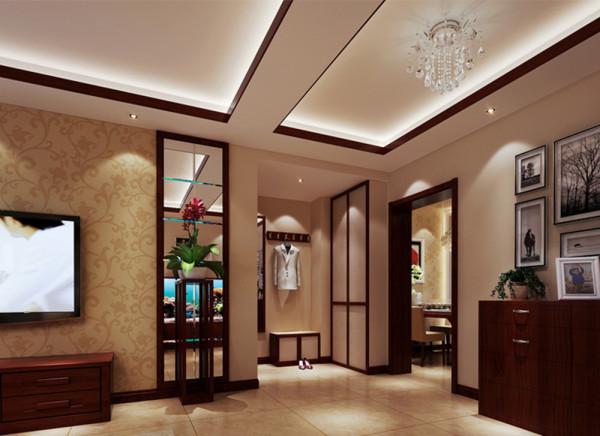 门厅空间的利用与管道的结合。设计理念 :原入户门处有许多裸露在外的管道,设计师通过衣帽柜的处理手法在掩藏管道的基础上为入户门增添了一组衣帽柜和换鞋凳,使主人的生活有一个质的提升