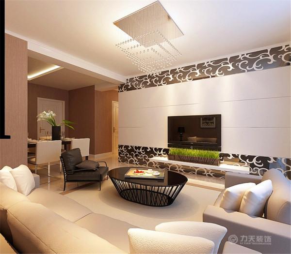 电视背景墙采用石膏板拉缝与磨花玻璃相结合,黑白相间,现代感更加突出