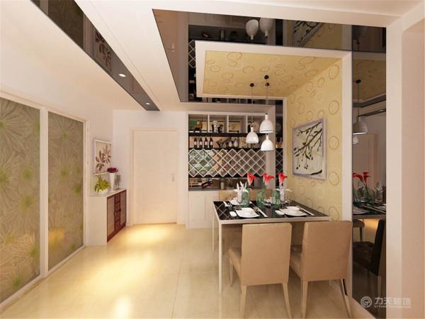餐厅造型与客厅相呼,顶面自然延伸至墙面,很好地划分了区域。餐桌椅的材质同样呼应了客厅,使两个空间自然融合。一个现代的酒柜,展示出了主人收藏的精品,餐桌上的装饰品让就餐氛围显得温馨浪漫