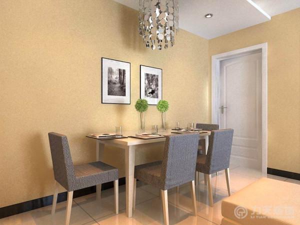 布艺颜色用的是和整体空间相呼应的比较稳重的蓝色,非常的简洁时尚,客餐厅整体空间墙面都刷了咖啡色的乳胶漆,并在餐桌对面墙面挂了两幅现代感极强的装饰画,使空间显得不会那么空,使整体风格更统一。
