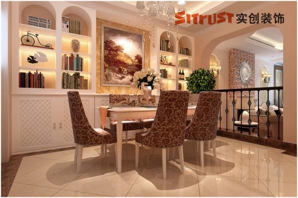 餐厅:装饰性与功能性并重的靓丽餐厅 从客厅贯穿餐厅,顶面吊顶造型既体现了区域的划分又有连贯性,结合顶面的灯池和墙面整体酒柜,使整个空间温馨不失优雅。