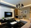 在电视背景墙部分 运用黑白两色的石材,用钢条进行连接,石材的拉缝,让整个电视墙更加的调理美观, 大面积的大花白石材的运用,让空间显得大气时尚。