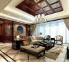 """背景墙采用中国元素中的镂刻纹理造型,象征着吉祥和如意!新中式的沙发结合清代家具。透漏出""""新""""与""""旧""""的岁月美感!中式的吊顶,结合欧式的水晶灯,更符合主任所要求的在中式风格中希望保留点西式元素!"""