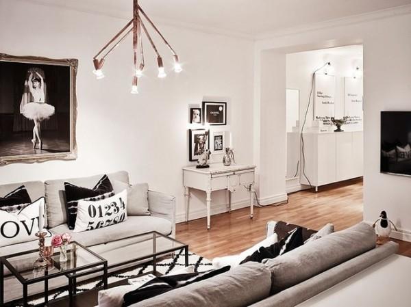 这间迷人的公寓充满了有趣的装饰元素,彷彿刻意的避免极简主义的影子,儘管有一些现代的家具存在,温暖的氛围蔓延整个空间,魔法般的装饰让你感到惊奇,不由得想要去感受躺在靠垫上的感觉,还有那地毯、毛毯和画作。