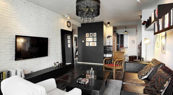 我们不需要教条的装饰,屋内的灯光开启,冷酷的黑白灰展示出细腻的温馨质感。