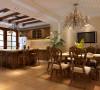 餐厅墙面运用暖色调,顶面采用石膏板拉槽造型装饰,配以欧式古典的家具.。