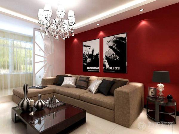 沙发背景墙是整体一面墙是用深红的乳胶漆搭配黑色的画为主,来衬托整个空间的亮点及色彩对比度。