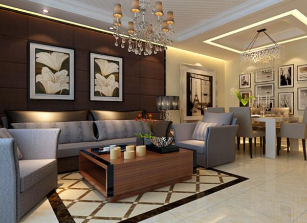 室内摆放灰色系组合沙发,配合电视柜及装饰品,为空间雕塑生动的跨界美感