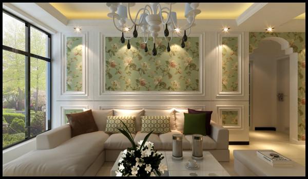 沙发背景墙也是全屋的设计重点,整个客厅的采光分配是的沙发背景墙的采光比较好,在沙发背景墙做了一个简单的方形造型和整体风格相互搭配的小碎花壁纸。