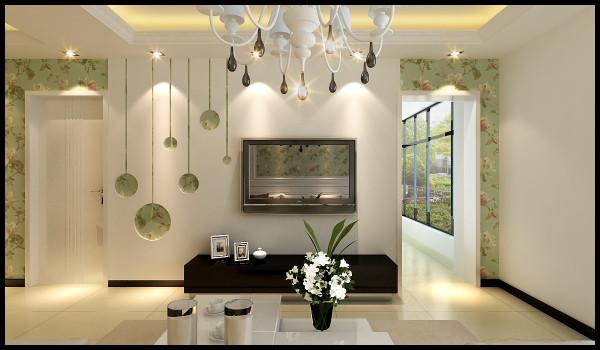 电视背景墙是入户的一个亮点,本案用的是简单的石膏板造型搭配小碎花的壁纸,电视墙的造型也是和阳台的垭口相互搭配的,简单温馨。