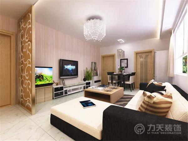 客厅顶面用L形顶划分空间,同时用灯带加以装饰,丰富顶面内容。沙发为黑白经典搭配,简约干练,墙面的装饰画同样现代感十足。