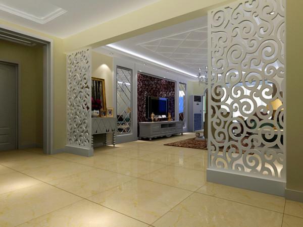 把客厅和门厅之间设计了镂空图案隔断,不仅隔开两个功能区域,还能制造出错落有致的光影,使得光线能随着人与日光的变换而变换,让客厅倍具时尚感。整个家居空间浑然一体,让人觉得自然、温暖 、 柔和。
