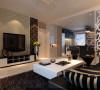 设计理念:灰色的墙面,黑色的造型,白色的顶面,黑白灰的简单色调,搭配少许浅绿色壁纸色的使用,在低调的单色世界里融合了宁静的气息。