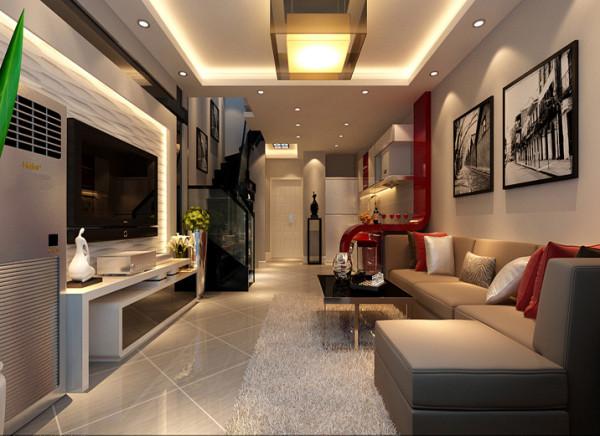 客厅设计地面采用45度菱形斜铺增加地面的灵动性,看起来不会单调刻板。开放式的厨房和客厅的贯通使整体空间倍增,同时厨房的采光问题也得以解决。