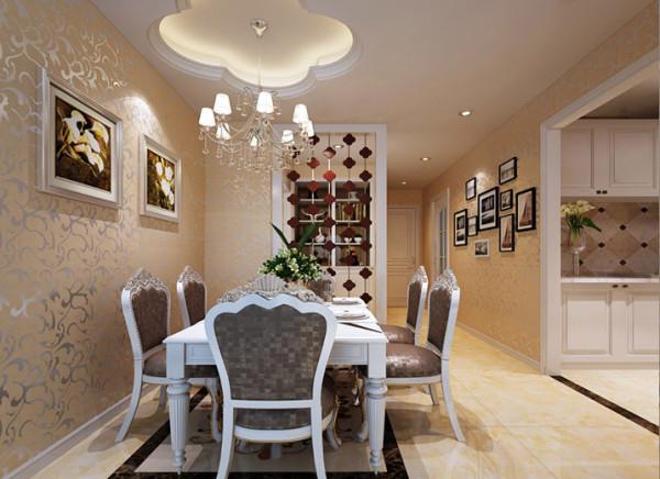 餐厅的地面拼花,墙面挂饰,顶面造型与灯具,无不与客厅形成呼应,吊顶改造成花型,用来搭配简欧风格的皮质雕花餐桌椅;而相连的厨房改造成开放式,兼具了休闲娱乐的功能,实用且使空间变的活泼了起来。