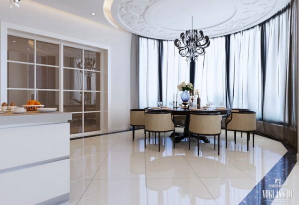 餐厅奉行简约、雅致的原则,在材质的选择上,大多采用黑檀等珍稀名贵木材,注重精雕细琢,集艺术、养生、为一体。餐桌上的陶艺清澈、干净,插几大朵白色的山茶或牡丹,简约而富有生活的情趣。