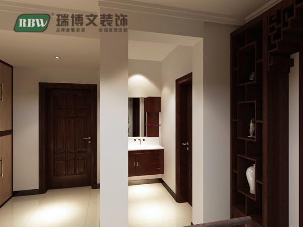 在此图中,主要体现的是客卫的干湿分区的干区,干区没有过多的修饰,简单的中式胡桃木浴室柜足以。使得客人及家人洗漱很方便。