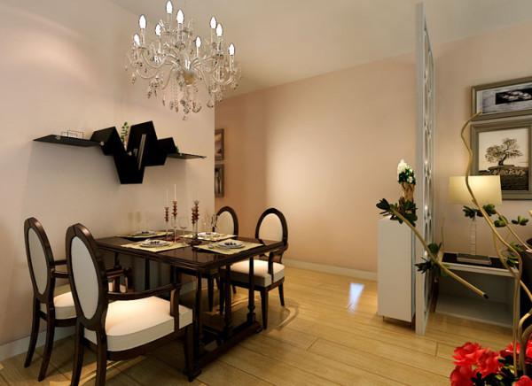 餐厅加上一串水晶吊链灯光打在水晶上折射出的微光更加给人一种朦胧平添了一份惬意,白色的隔断加上餐厅墙的造型更能显示出简约中的那份高雅。