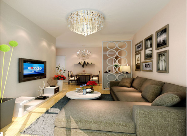 卡其色的沙发,灰色的地毯,好似给人错觉置身在一个巧克力中舒适甜美,配合上一盏淡黄色朦胧的吊灯在简单的沙发墙上装上几副映像派的画像配合着浅暖色的墙漆使得简约并不那么简单