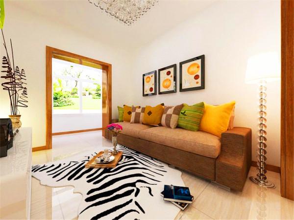客厅的沙发选用深色布艺,压制了白色的飘逸感,墙上的咖啡色装饰画与整体色调呼应。