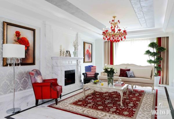 白色和红色的搭配让客厅显得格外高贵大气,一束香槟玫瑰,两幅红色玫瑰,让空间气氛达到极致,理石墙面造型让整体空间更加细腻精致,像极了有着高贵气质的model,有着强大的气场。
