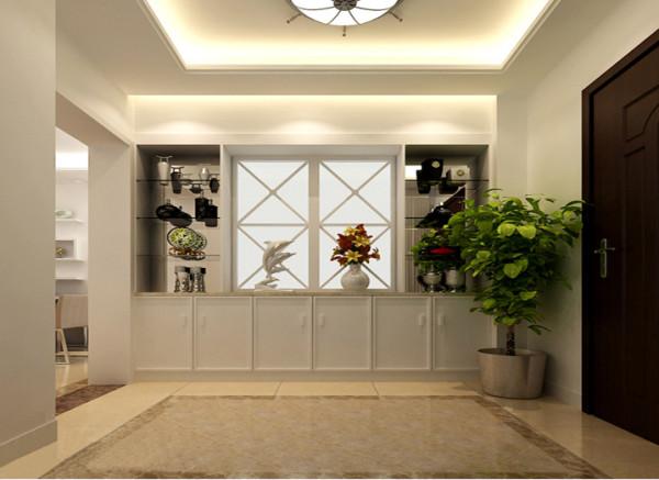 设计理念:入户玄关柜作隔墙功能,节省空间,既有装饰性,又有储物功能。