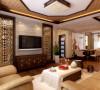 中式特有的棕色八角边元素吊棚,衬托和谐庄严的气氛.电视背景墙设计师把墙体打开,做了俩个镂空的隔断,金色隔断体现中国传统室内装饰