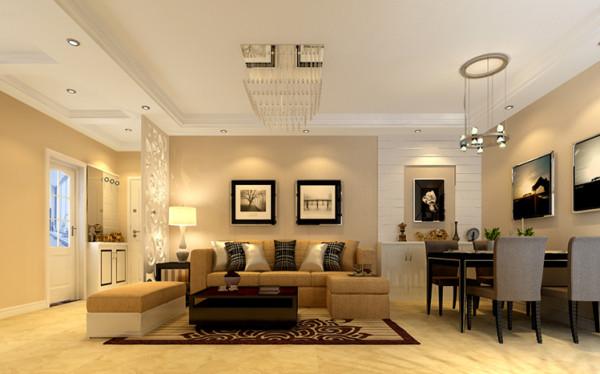 沙发背景墙采用黑白色的挂画作为背景。沙发和过道之间用精美的隔断隔开,分成了两个功能间。
