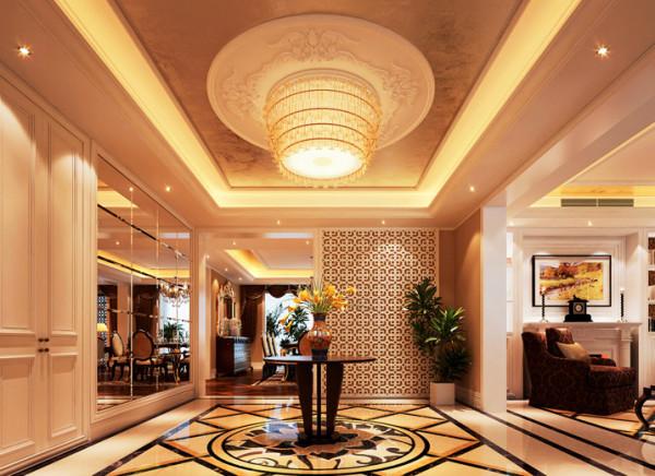 设计理念:入户门厅是进入一个家庭时最直接展现主人品位的空间,是设计的重中之重。亮点:移动性屏风,精美的顶面雕花,大气豪华的大理石拼花。