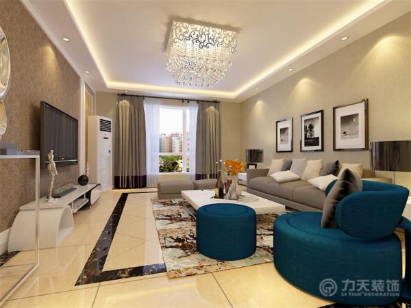 沙发背景墙以简单的现代挂画加以装饰,地面铺800*800的米黄色地砖,吊顶采用回字形发光灯池的造型,整个空间显得大气、美观,体现了主人的品格、地位