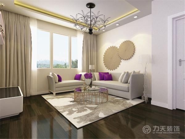 客餐厅的整体色调为浅灰棕色,沙发背景墙没有做过多造型,只是装饰了具有抽象元素的圆形挂饰