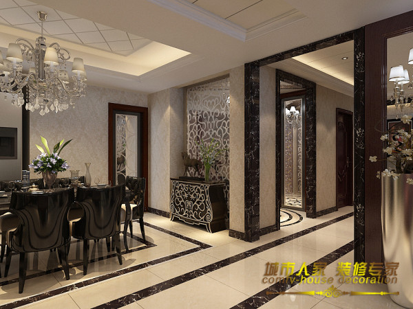 地面上的黑色花纹石材经过道与餐厅区分开来,使整个房子的空间更加清晰。