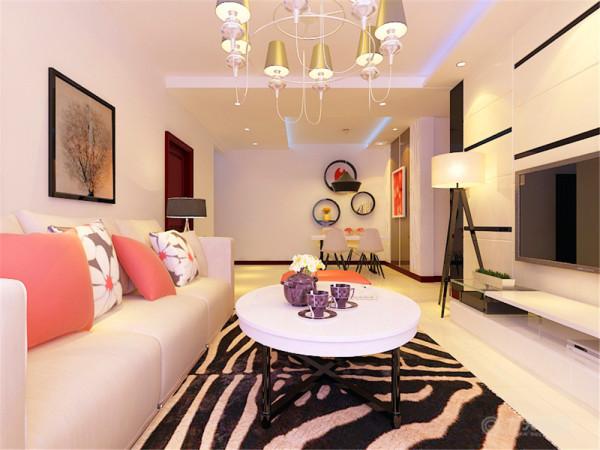 家具方面,米色的沙发与地面瓷砖颜色相似,主要能够凸显出红色的靠枕以及沙发座。茶几与电视柜的造型虽然很简单,但是却能够极好的表现出现代简约的设计元素
