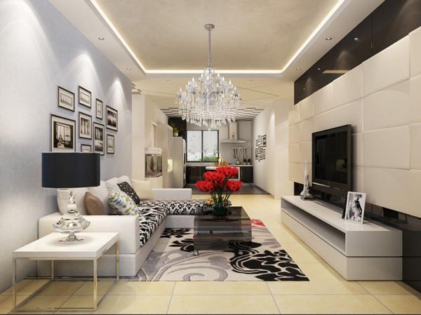 沙发线条简约流畅,色彩对比强烈,且具有完整的功能性。沙发背景墙上的装饰画很好的表现出强烈的现代感。餐厅和厨房是家居生活的心脏,不仅要美观,更重要的实用性,整体性