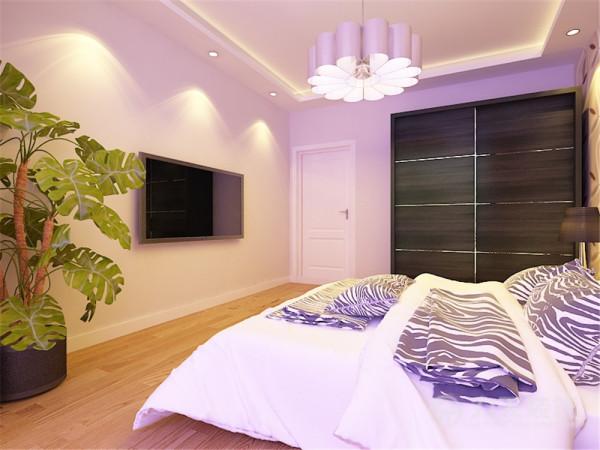 主卧的风格同样为现代简约风格,背景墙铺贴了具有流动性线条的灰棕色壁纸。搭配现代风格的家具,更显时尚。主卧吊顶与客厅同为圈形吊顶。