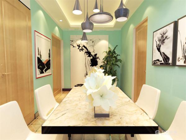 餐厅是家居生活的心脏,不仅要美观,更重要的实用性,整体性。在确立风格之后,又考虑到利用了挂画设计,这个布局以实现特定需要的风格情调。