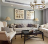 简单的布局,清新淡蓝色的墙面处理,白色的沙发以及各种几何花纹的抱枕,打造出一个简约时尚的现代空间。